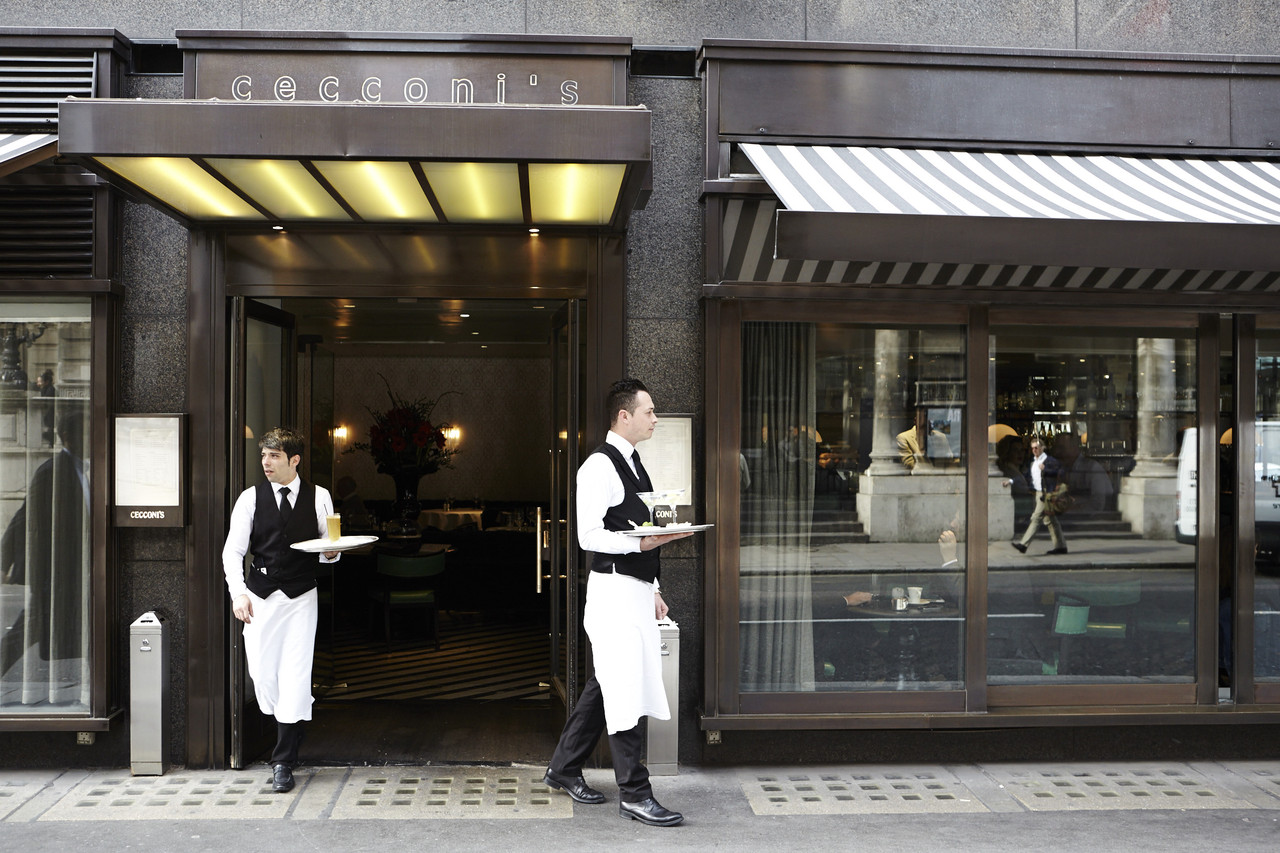 Waiters carrying drinks outside